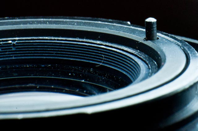 View of the diaphragm pusher of the lens MC ZOOM ARSAT M 80-200mm 4.5