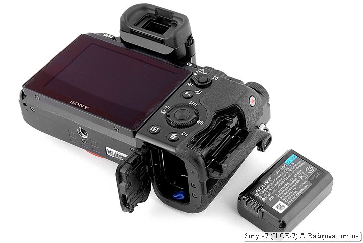 Sony a7, battery compartment, memory card slot and battery view